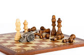 Battle with a gun on a chess board — Stock Photo