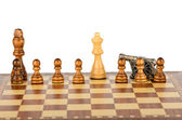 The battle on the chessboard with a gun — Stock Photo
