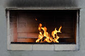 The fire in the fireplace of brick — Stock Photo