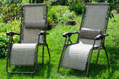 Two chaise lounge in the summer garden — Stock Photo