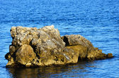 A rock in the sea — Stock Photo