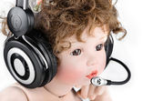 Doll with a headset — Stock Photo