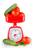 Vegetables and scales — Stock Photo