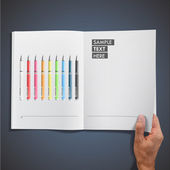 Open white book with colorful pens inside. Vector design. — Stock Vector