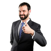 Young businessman getting OK over white background — Stock Photo