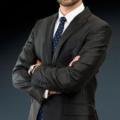 Business man with his arms crossed over isolated background — Stock Photo