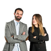Couple with their arms crossed over isolated background — Stock Photo