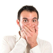 Young man surprised over white background — Stock Photo