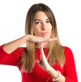 Young girl making time out gesture over white background — Stok fotoğraf