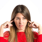 Cute girl covering her ears over isolated white background — Stock Photo