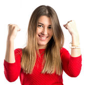 Young woman winner over isolated white background — Stock Photo