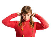 Young pretty woman covering her ears over white background — Stock Photo