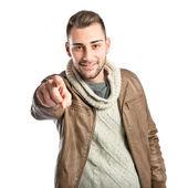 Jonge man wijzen over geïsoleerde witte achtergrond — Stockfoto
