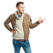 Young man pointing to his right over white background — ストック写真