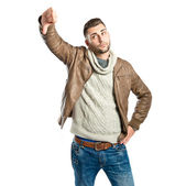 Young man with thumbs down over white background — ストック写真