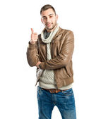 Man making an OK gesture over isolated white background — Stock Photo