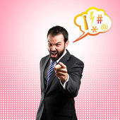 Businessman angry and shouting over pink background — Stock Photo