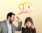 Businessman screaming at his girlfriend over yellow background — ストック写真