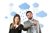 Couple with their thumbs down under the rain — Stock Photo