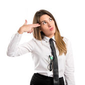 Young businesswoman making suicide gesture over white background — Stock fotografie