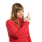 Young girl making horn gesture over white background — Stock Photo