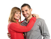 Happy couple over isolated white background — Stock fotografie