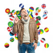 Young man thinking over background with flags — Stock Photo