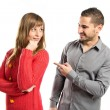 Man pointing his girlfriend over white background — Stock Photo