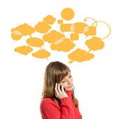 Jeune fille parlant sur mobile sur fond blanc — Photo