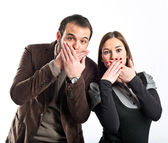 Couple doing surprise gesture over white background  — Stock Photo