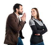 Men pleading at his girlfriend over white background  — Stock Photo