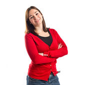 Young woman with hers arms crossed over white background  — Stock Photo