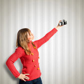 Girl taking a picture over textured background  — Foto de Stock
