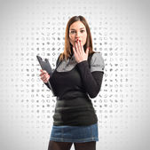 Young student doing surprise gesture over grey icons background  — Stock Photo