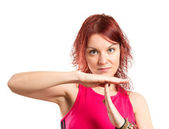 Beautiful young girl making time out gesture over white background — Stock Photo