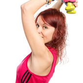 Young girl doing weightlifting over white background  — Foto de Stock