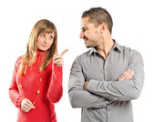 Woman pointing his girlfriend over white background  — Stock Photo
