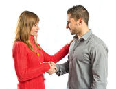 Couple making a deal over isolated white background  — Stock Photo