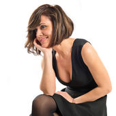 Pretty brunette woman with black dress over white background  — Foto Stock