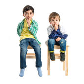 Kids doing silence gesture over white background  — Stock Photo