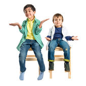 Kids with doubts over white background  — Stock Photo