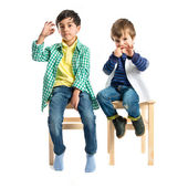 Kids doing the ok sign over white background  — Stock Photo