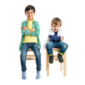 One kid happy and other serious over white background  — Foto Stock