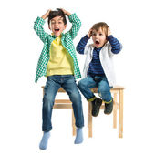 Kids frustrated over white background — Stock Photo