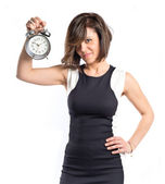 Pretty woman holding an antique clock over white background  — Photo