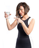 Pretty girl holding an empty bottle of glass over white background  — Stock Photo