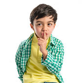 Kid doing silence gesture over white background  — Stock Photo