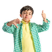 Kid making Ok and bad gesture over isolated background  — Stock Photo