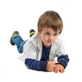 Cute blonde kid on the floor over white background  — Stock Photo
