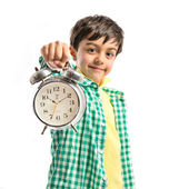 Boy holding an antique clock over white background  — Foto de Stock